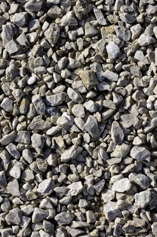 Close-up of large gravel texture at sunset